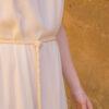 Detail woman wearing white wild silk dress