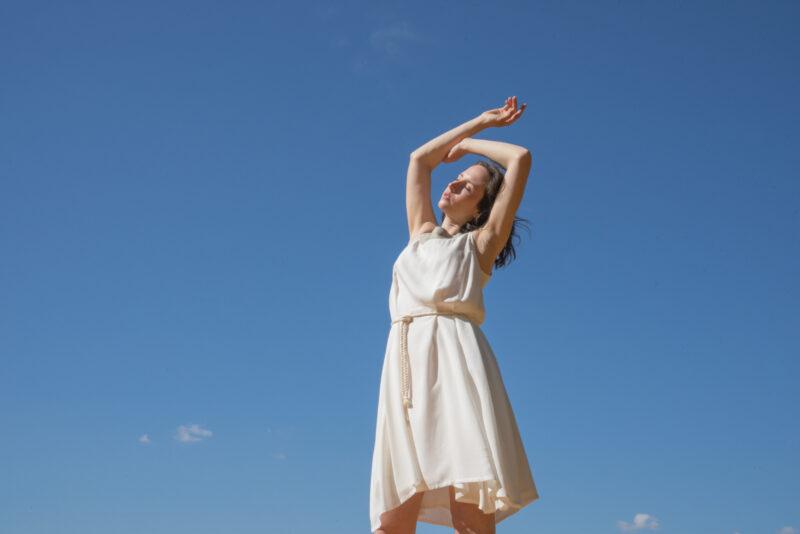 Woman wearing wild silk white dress