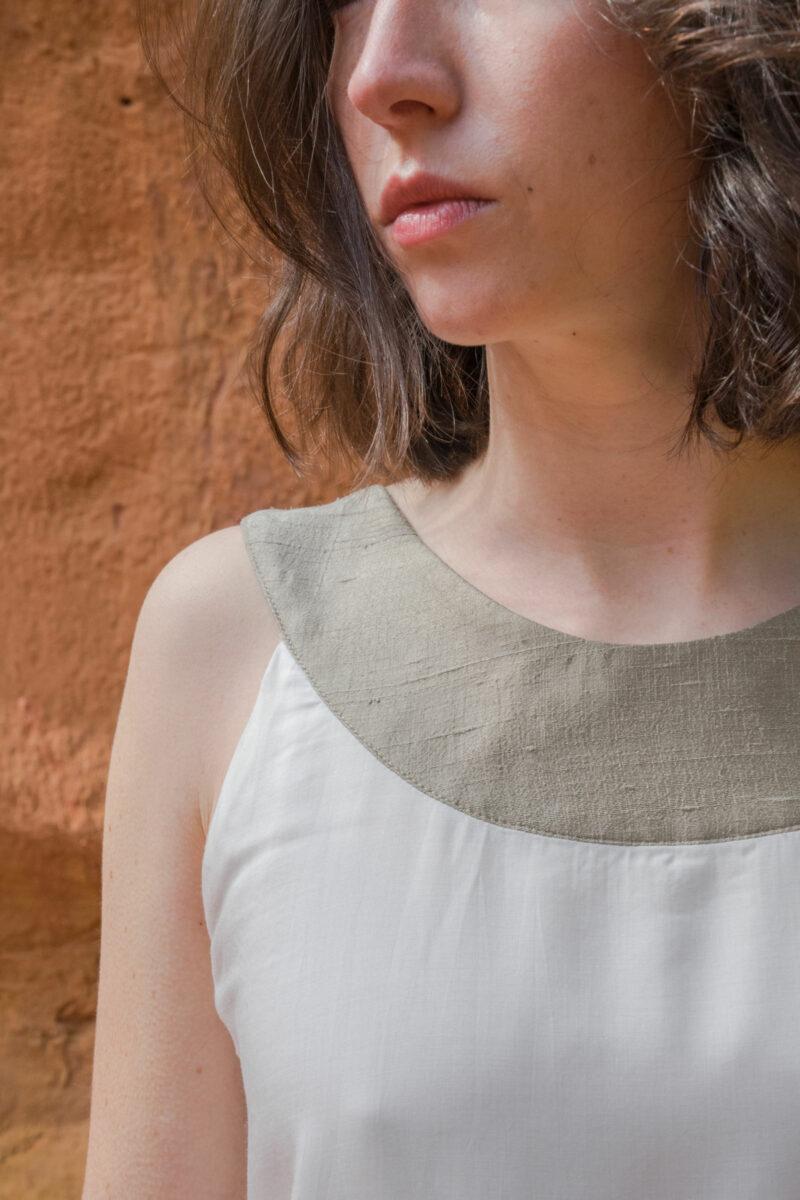 femme portant top soie blanc détail